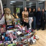 Cotton Court team and Barnardo's collecting gifts from 2019 appeal.